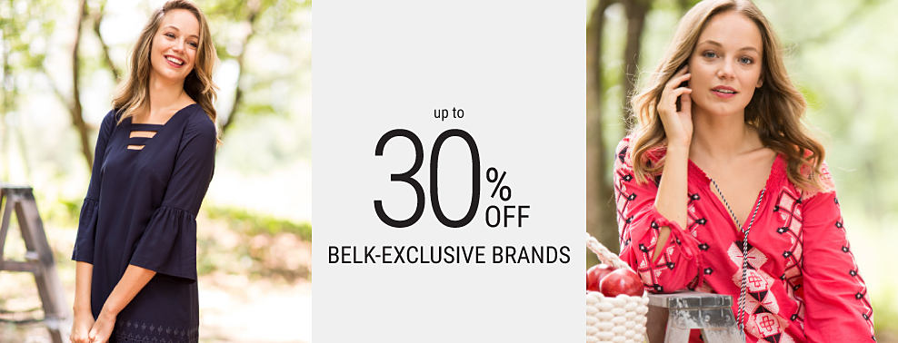 A woman wearing a navy dress. A woman wearing a red, white & black patterned top & blue jeans. Up to 30% off Belk-exclusive brands featuring Crown & Ivy.