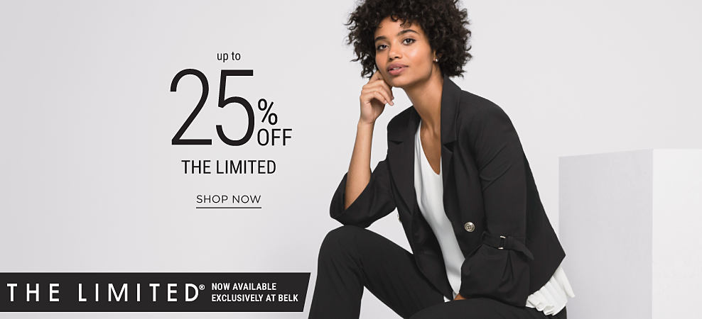A woman wearing a black jacket, white top, black pants & black shoes. Up to 25% off THE LIMITED. Shop now.