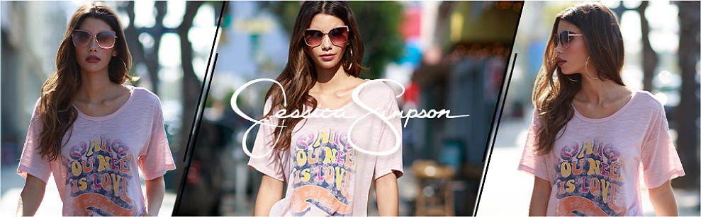 A woman in a light pink graphic tee, sunglasses and hoop earrings. Jessica Simpson. Shop now.