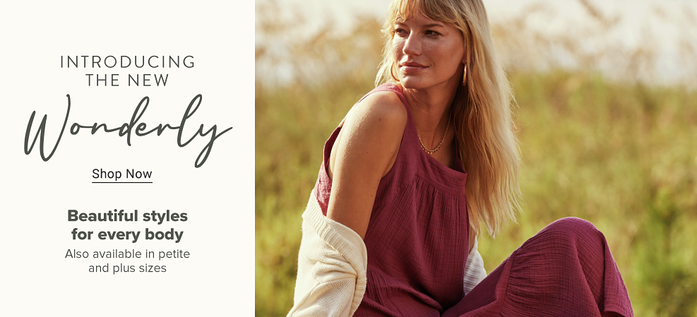 A woman wears camouflage-print pants and an ivory top that says kindness is everything. Attention. New looks have landed. Shop new arrivals.