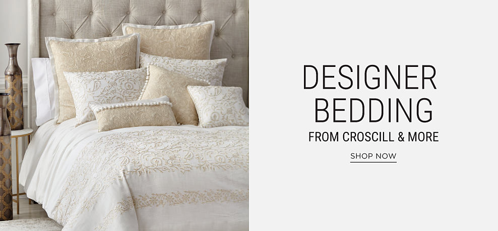 A bed made with a white & beige textured comforter & matching pillows. Designer bedding from Croscill & more. Shop now.