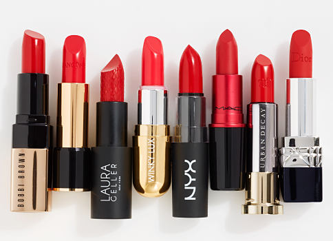 An assortment of lipsticks in a variety of red shades. Red lips. A bold kiss of color. Shop now.