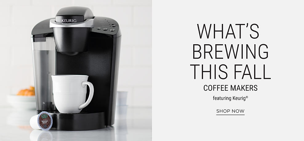 A Keurig coffee maker with a white coffee cup & a K cup coffee pod. What's Brewing This Fall. Coffee makers featuring Keurig. Shop now.
