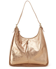 A gold metallic leather Hobo handbag. Shop Hobo.