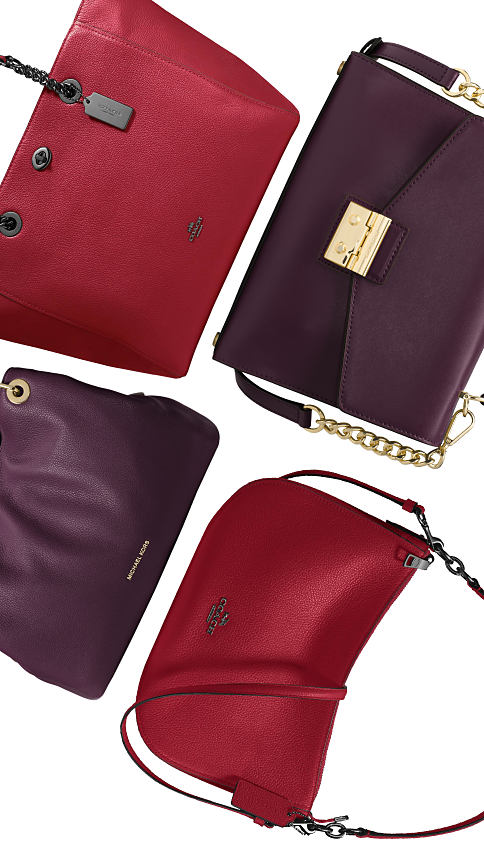 A purple leather handbag & a red leather handbag. Purple & Red. 2 of our favorite fall hues. Shop now.