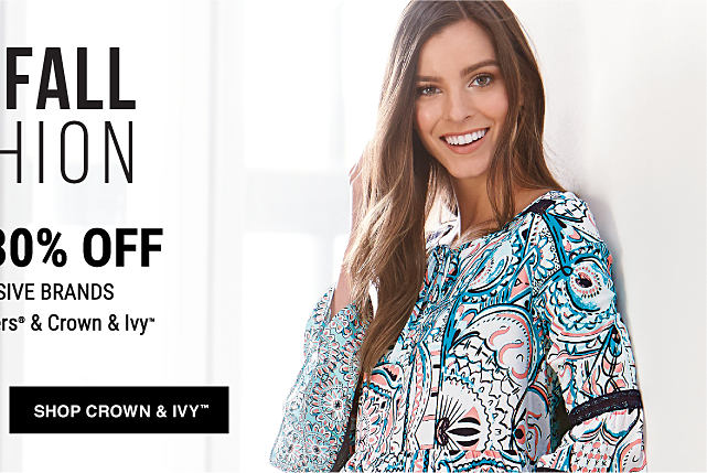 A woman wearing a Crown & Ivy patterned top. Up to 30% off Belk Exclusive Brands featuring Kim Rogers & Crown & Ivy. Shop Crown & Ivy.