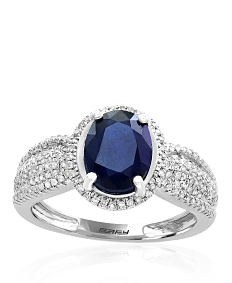 A silver, diamond & blue diamond ring. Shop fine jewelry rings.