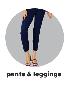 A woman in ankle length skinny jeans and sandals. Pants and leggings.