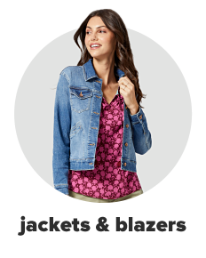 A woman wears a denim jacket over a red floral shirt. Shop jackets and blazers.
