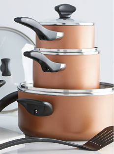 3 brown pots & a black spatula. Shop kitchen.