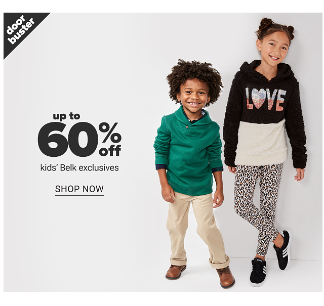 A boy wearing a green hoodie over a blue long sleeved shirt, beige pants & brown shoes standing next to a girl wearing a black & white colorblock hoodie with a multi colored Love front graphic, leopard print pants & black sneakers with white stripes. Doorbuster. Up to 60% off kids Belk exclusives. Shop now.