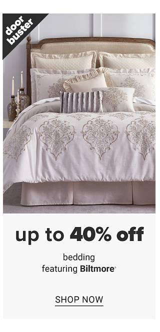 A bed made with a white & beige patterned print comforter & matching pillows. Doorbuster. Up to 40% off bedding featuring Biltmore. Shop now.