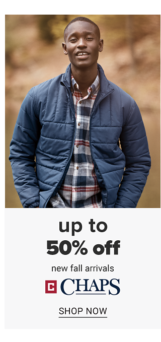 A man wearing a navy puffer coat over a plaid long sleeved button front shirt. Up to 50% off new fall arrivals from Chaps. Shop now.