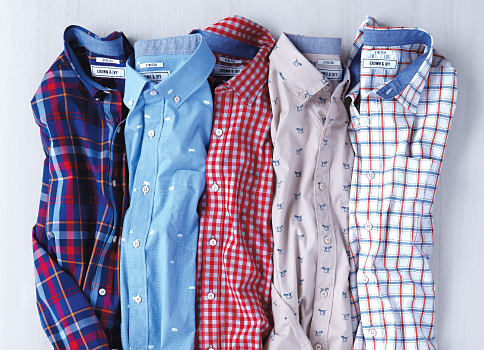 An assortment of multi-colored plaid button-front shirts. Shop Crown & Ivy.