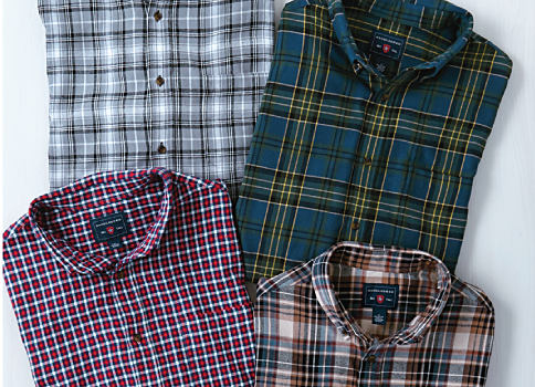 An assortment of multi-colored plaid button-front shirts. Shop Saddlebred.