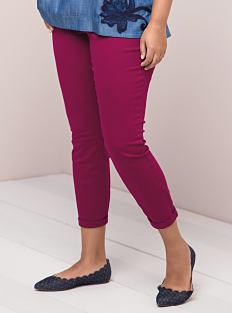 A woman wearing fuchsia pants & black flats. Shop pants.
