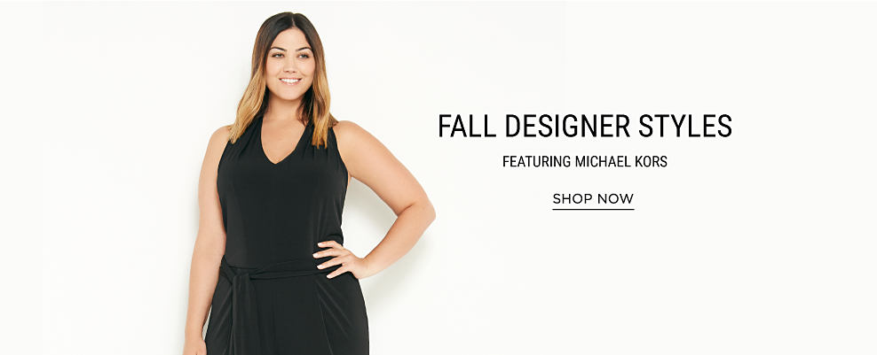 A woman wearing a sleeveless black dress. Fall designer styles featuring Michael Kors. Shop now.