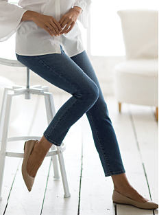 A woman wearing jeans & flats. Shop jeans.