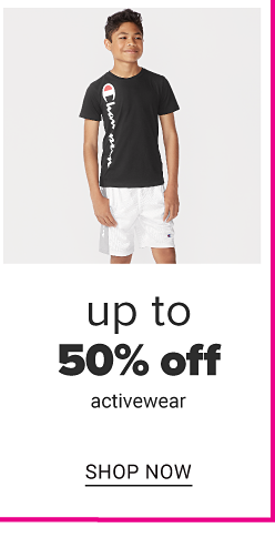 A little boy with a black Champion tee and white shorts. Up to 50% off activewear. Shop now.