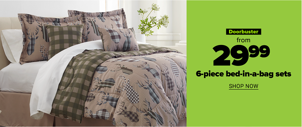 A brown reversible comforter set with matching pillows. One side with a pattern of repeating deer outlines with varying patterns inside the outline, including tartan and stripes. The other side features two tones of brown in a tartan pattern. Doorbuster. From $29.99 six piece bed in a bag sets. Shop now
