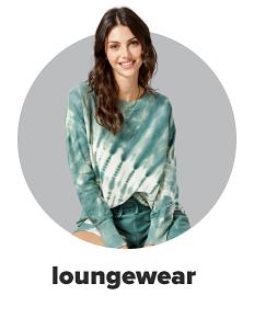 A woman wears a two-piece lounge set in green tie-dye. Shop loungewear.