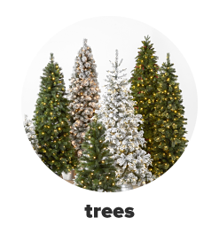 An assortment of green and white artificial Christmas trees. Trees.