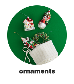 A stocking with Christmas ornaments spilling out.