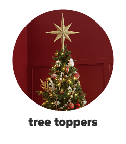 A Christmas tree with a big gold star on top. Tree toppers.