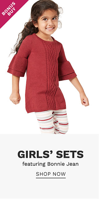 A girl wearing a red short sleeved top & white leggings with red & gray horizontal stripes. Bonus Buy. Girls sets featuring Bonnie Jean. Shop now.