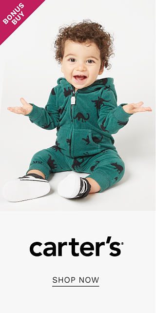 A baby boy wearing a teal hoodie with a navy all over dinosaur print, matching pants & blue & white sneakers. Bonus Buy. Carters. Shop now.