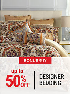 A bed made with a multi-colored patterned comforter & matching pillows. Up to 50% off designer bedding. Shop now.