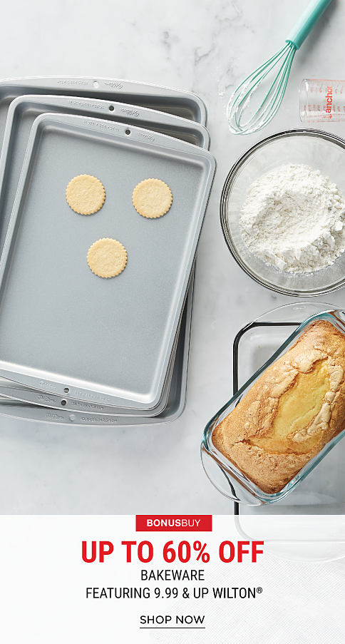 A stack of cookie sheets with cookie dough. A glass mixing bowl with flour in it. A glass bread pan with bread in it. A whisk & a measuring cup. Bonus Buy. Up to 60% off bakeware featuring 9.9.9 & up Wilton. Shop now.