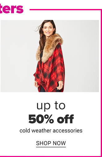 A woman wearing a red & black plaid faux fur collared poncho. Up to 50% off cold weather accessories. Shop now