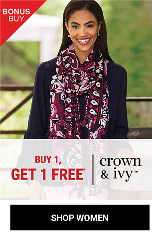 A woman wearing a black top & a multi-colored print scarf. Bonus Buy. Buy 1, Get 1 Free Crown & Ivy. Free item must be of equal or lesser value. Shop women.