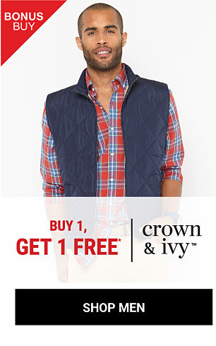 A man wearing a navy puffer vest & a red, blue & white plaid button-front shirt. Bonus Buy. Buy 1, Get ! Free Crown & Ivy. Free item must be of equal or lesser value. Shop men.