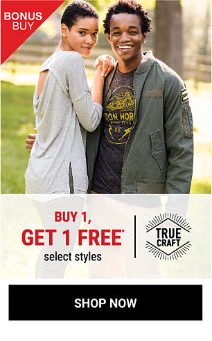 A young woman wearing a gray sweater standing next to a young man wearing a military jacket & a blue & yellow screen print T-shirt. Bonus Buy. Buy 1, Get ! Free select True Craft styles. Free item must be of equal or lesser value. Shop now.