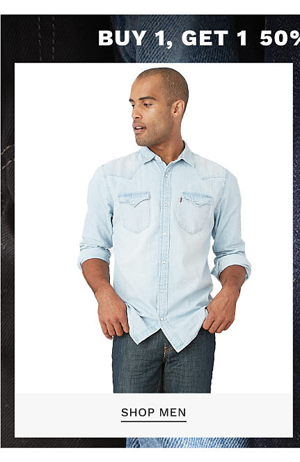Buy 1, Get 1 50% off select Levi's for the family. Free or discounted items must be of equal or lesser value. A man wearing a white long sleeved button front shirt & blue jeans. Shop men.