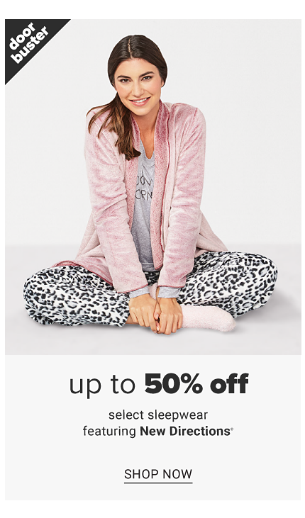 A young woman wearing a pink velvet robe over a gray top, leopard print pants & white socks. Doorbuster. Up to 50% off select sleepwear featuring New Directions. Shop now.