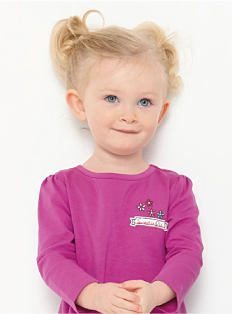 A toddler girl wearing a fuchsia top. Shop toddler girls.