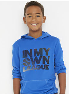 "A boy wearing a blue hoodie with ""In My Own League"" front graphic. Shop boys 8-20."
