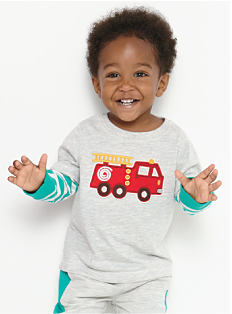 A toddler boy wearing a gray long-sleeved shirt with teal stripes on the sleeves & a red fire truck front graphic, gray pants with teal stripes on the side. Shop toddler boys.
