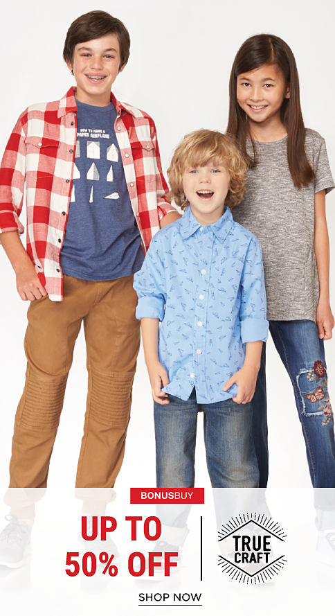 A boy wearing a red & white plaid button-front shirt, a blue & white graphic tee & khaki pants standing next to a boy wearing a blue patterned button-front shirt & blue jeans & a girl wearing a gray short-sleeved tee & distressed jeans with & a girl wearing a gray short-sleeved tee & dsitressed blue jeans with a floral & butterfly side applique. Bonus Buy. Buy 1, Get 1 Free True Craft. Free item must be of equal or lesser value. Shop now.