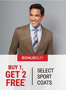 A man wearing a brown sport coat, a light blue dress shirt & a multi-colored plaid tie. Buy 1, Get 2 Free select sport coats. Free items must be of equal or lesser value. Shop now.
