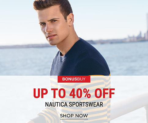 A young man wearing a blue & maize striped sweater. Bonus Buy. Up to 40% off Nautica sportswear. Shop now.