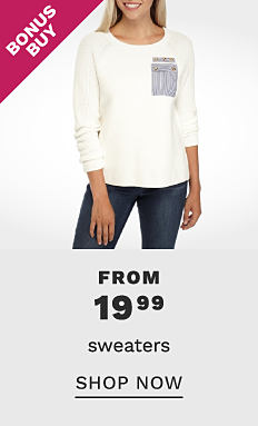A woman wearing a white long sleeved top with gray front pocket detail & blue jeans. Bonus Buy. From 19.99 sweaters. Shop now.