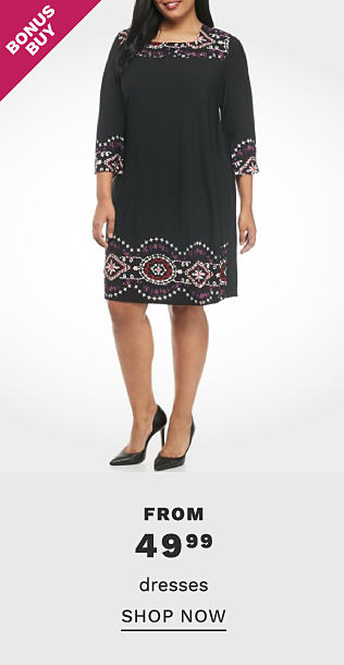 A woman wearing a black short sleeved dress with white patterned print detail at the sleeve hems & bottom hem & black heels. Bonus Buy. From $49.99 dresses. Shop now.