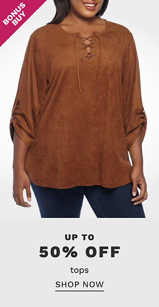A woman wearing a brown velvet long sleeved top & blue jeans. Bonus Buys. Up to 50% off tops. Shop now.