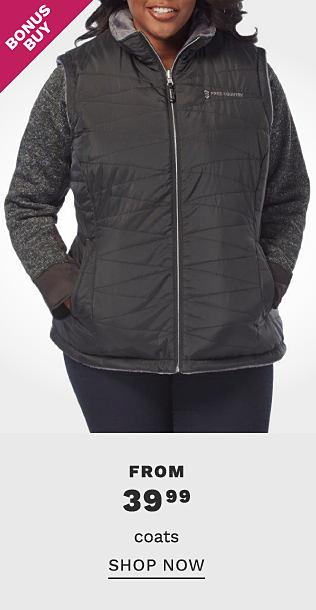 A woman wearing a black puffer vest over a gray fleece top & blue jeans. Bonus Buy. From $39.99 coats. Shop now.