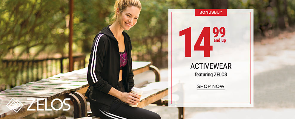 A woman wearing a burgundy sports bra & a black track suit with white stripes on the sides. Bonus Buy. 14.99 & up activewear featuring Zelos. Shop now.