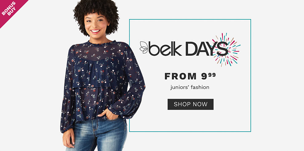 A young woman wearing a black long sleeved top with a multi colored floral print & blue jeans. Belk Days. Bonus Buy. From $9.99 juniors fashion. Shop now.